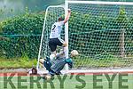 Ball breaks between CS Clochain Breannainn keeper Luke Mulally and Mark Wren of Castlemaine Utd in the Denny Division 1B League Final