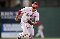 First baseman Sam Travis (28) of the Greenville Drive tracks a pop fly in a game against the Charleston RiverDogs on Thursday, August 21, 2014, at Fluor Field at the West End in Greenville, South Carolina. Travis is a second-round pick of the Boston Red Sox in the 2014 First-Year Player Draft out of Indiana University. Charleston won, 12-0. (Tom Priddy/Four Seam Images)