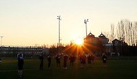 Photo: Richard Lane/Richard Lane Photography. Wasps team run at Stadio Sergio Lanfranchi ahead of their European Champions Cup game against Zebre at Parma. 21/01/2017. Wasps players go through their paces as the sun goes down.