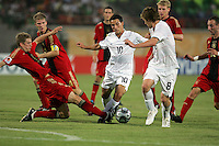 The United States' Dilly Duka (10) fights off multiple German players during the FIFA Under 20 World Cup Group C Match between the United States and Germany at the Mubarak Stadium on September 26, 2009 in Suez, Egypt. The US team lost to Germany 3-0.