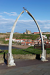 Great Britain, England, North Yorkshire, Whitby: View through Whale Bones to town and Saint Mary`s Church and Whitby Abbey