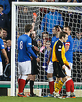 Lee Wallace is shown red by ref Paul Robertson