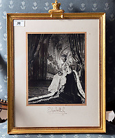 BNPS.co.uk (01202 558833)<br /> Pic: PhilYeomans/BNPS<br /> <br /> The house is full of Royal momento's, Cecil Beaton photograph of the Queen on her Coronation - Ian Thomas worked on the embroidered silk dress.<br /> <br /> A remarkable 'time warp' Royal archive amassed by the Queen's dressmaker has been found inside his old country home.<br /> <br /> The late Ian Thomas was a dress designer for members of the Royal Family, including Her Majesty, for over 30 years.<br /> <br /> As an apprentice he worked alongside the renowned fashion designer Norman Hartnell on creating the Queen's coronation dress in 1953.<br /> <br /> His archive includes embroidered samples of the gown worn by Elizabeth II for the historic ceremony in Westminster Abbey that was broadcast to millions.<br /> <br /> Mr Thomas also designed outfits for the Queen Mother and Princess Margaret.