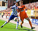 KILMARNOCK'S TIM CLANCY AND DUNDEE UTD'S PAUL DIXON CHALLENGE FOR THE BALL