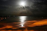 Full moon night at red sand beach.