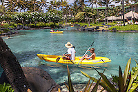 Families kayaking in lagoon at at Grand Hyatt Kauai Resort in Koloa, Kaua'i