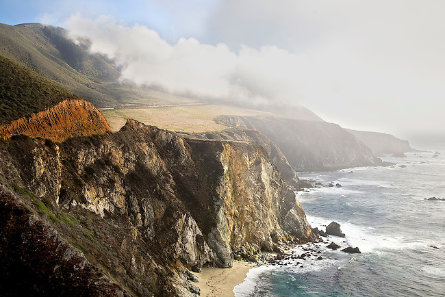 FOG AND DARK CLOUDS ROLL INTO HURRICANE POINT AT THE BIG SUR COASTLINE ALONG THE PACIFIC OCEAN, CALIFORNIA