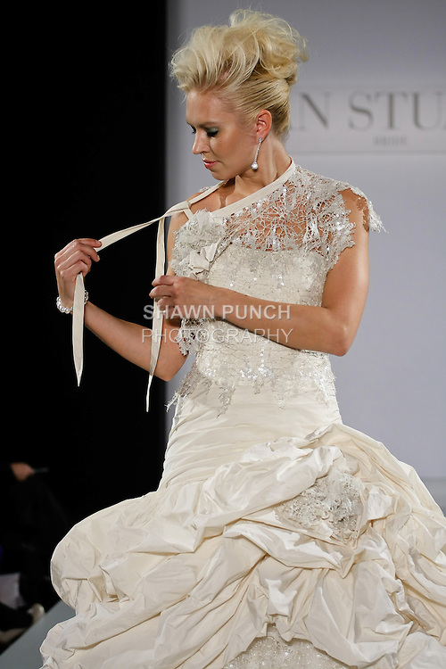 Model walks runway in a Monsoon wedding dress from the Ian Stuart - Supernova Bridal Collection 2013 fashion show, at the Couture Show during New York Bridal Fashion Week, October 14, 2012.