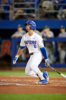 Florida Gators Jonathan India (6) hits a solo home run in the bottom of the fourth inning during a game against the Siena Saints on February 16, 2018 at Alfred A. McKethan Stadium in Gainesville, Florida.  Florida defeated Siena 7-1 in both teams opening game of the season.  (Mike Janes/Four Seam Images via AP)