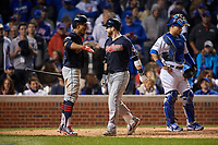 Cleveland Indians Jason Kipnis (22) celebrates with Francisco Lindor (12) after hitting a home run as Wilson Contreras (40) looks on in the seventh inning during Game 4 of the Major League Baseball World Series against the Chicago Cubs on October 29, 2016 at Wrigley Field in Chicago, Illinois.  (Mike Janes/Four Seam Images)