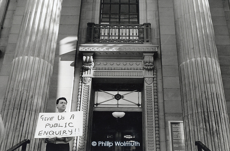 A member of Westminster Association of Relatives protersts outside Westminster City Council at the sale of 3 cemeteries for 15p.