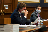 """U.S. Securities and Exchange Commission Chairman Jay Clayton adjusts his protective mask as he testifies before a House Committee on Financial Services hearing entitled """"Capital Markets and Emergency Lending in the COVID-19 Era"""" in the Rayburn House Office Building on Capitol Hill in Washington, DC., Thursday, June 25, 2020. <br /> Credit: Rod Lamkey / Pool via CNP/AdMedia"""
