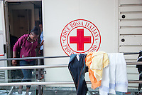 Italy. Lombardy Region. Como. Homeless african migrants live near the San Giovanni railway station. The italian Red Cross from Como has provided two trailers with toilets and showers. A group of Eritrean women are stepping out of the female trailer. A laundry with clean clothes is drying on a guard-rail. The Italian Red Cross (IRC, Italian: Croce Rossa Italiana or CRI) is the Italian national Red Cross society. 10.08.2016 © 2016 Didier Ruef