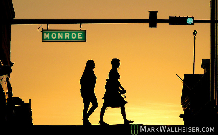 Football fans enjoy a fall sunset as they head to the Downtown GetDown on Friday nighst prior to a home FSU football game.