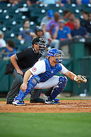 Home plate umpire Paul Clemons and Buffalo Bisons catcher Erik Kratz (40) during a game against the Lehigh Valley IronPigs on August 29, 2016 at Coca-Cola Field in Buffalo, New York.  Buffalo defeated Lehigh Valley 3-2.  (Mike Janes/Four Seam Images)