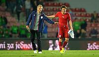 PRAGUE, Czech Republic - September 3, 2014: USA's coach Jurgen Klinsmann and Tomas Rosicky during the international friendly match between the Czech Republic and the USA at Generali Arena.