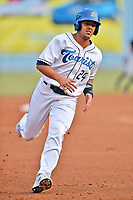 Asheville Tourists third baseman Colton Welker (24) runs to third base during a game against the Rome Braves at McCormick Field on June 12, 2017 in Asheville, North Carolina. The Tourists defeated the Braves 7-0. (Tony Farlow/Four Seam Images)