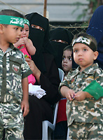 "Palestinian children wear green Hamas headbands during a police graduation ceremony in Gaza City, Thursday, Aug. 30, 2007.""photo by Fady Adwan"""