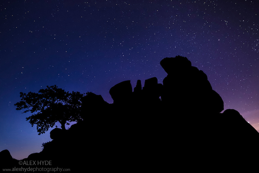 Robin Hood's Stride, an outcrop of gritstone, silhouetted against a starry night sky. Peak District National Park, Derbyshire. September