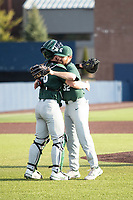 Michigan State Spartans pitcher Zach Iverson (32) hugs catcher Adam Proctor (28) after recording the last out against the Michigan Wolverines on March 22, 2021 in NCAA baseball action at Ray Fisher Stadium in Ann Arbor, Michigan. Michigan State beat the Wolverines 3-0. (Andrew Woolley/Four Seam Images)