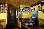The Village Pub. The Square and Compass, Worth Matravers, Dorset, England. Ray Newman the publican under a portrait of his late father also the publican of this 265 year old public house. 1991 1990s UK