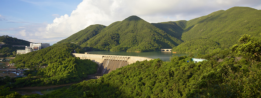 The dam and road on the Tai Tam Tuk Reservoir (1918), Tai Tam Group of Reservoirs.<br /> <br /> Twenty-one structures (together with the Bowen Road aqueduct) make up he 88th Declared Monument on Hong Kong Island.