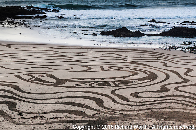 Temporary beauty.  Art, painted with a rake on a canvas of sand.