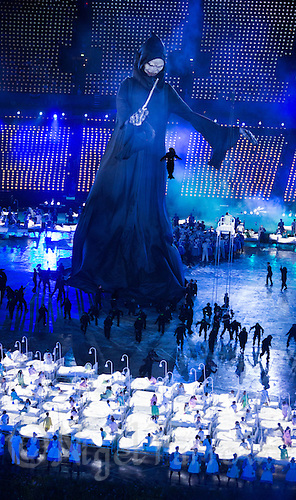 "27 JUL 2012 - LONDON, GBR - A giant puppet of Lord Voldemort from the Harry Potter series of books walks past childrens beds as part of a sequence celebrating  British children's literature during the ""Second To The Right, And Straight On Till Morning"" section of the Opening Ceremony of the London 2012 Olympic Games in the Olympic Stadium in the Olympic Park, Stratford, London, Great Britain .(PHOTO (C) 2012 NIGEL FARROW)"