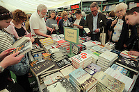 Pictured: People read books in the festival book store Monday 30 May 2016<br />Re: Hay Festival, Hay on Wye, Wales, UK