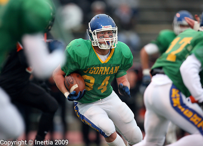 SIOUX FALLS, SD - OCTOBER 22:  Miles McLaughlin #34 of O'Gorman looks for an opening in the Washington defense in the second quarter of their game Thursday night at Howard Wood Field. (Photo by Dave Eggen/Inertia).
