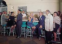 Lareine - Bradley Hotel. Women in mink coats & men in jackets at the bar.