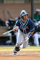 Second baseman Mason Davis (20) of the Citadel bats in a game against the University of South Carolina Upstate Spartans on Tuesday, February, 18, 2014, at Cleveland S. Harley Park in Spartanburg, South Carolina. Upstate won, 6-2. (Tom Priddy/Four Seam Images)