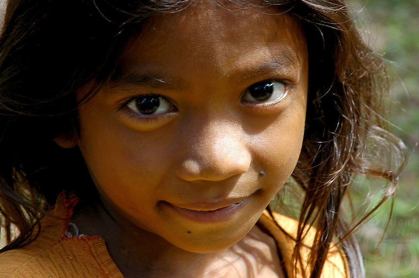 A shy young Girl in a temple, Angkor wat area. Cambodia