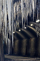 Tunnel along the Monsal Trail with a dramatic display of icicles during an extended period of freezing weather (photographed from outside the tunnel for safety, icicles can be shed at any moment). Peak District National Park, Derbyshire, UK. February.