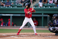 Right fielder Cole Brannen (5) of the Greenville Drive during a game against the Brooklyn Cyclones on Friday, May 14, 2021, at Fluor Field at the West End in Greenville, South Carolina. The catcher is Jose Mena (16). (Tom Priddy/Four Seam Images)