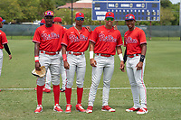 Philadelphia Phillies Felix Reyes (25), Jefferson Encarnacion (35), Leandro Pineda (2), and Jadiel Sanchez (53) (L-R) before an Extended Spring Training game against the New York Yankees on June 22, 2021 at the Carpenter Complex in Clearwater, Florida. (Mike Janes/Four Seam Images)