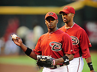 Apr. 2, 2010; Phoenix, AZ, USA; Arizona Diamondbacks outfielders Justin Upton (left) and Chris Young against the Chicago Cubs at Chase Field. Mandatory Credit: Mark J. Rebilas-