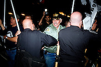 Police clash with members of Veterans for Peace at the OccupyBoston demonstration's second encampment at Rose F. Kennedy Greenway a block from Dewey Square, in downtown Boston, Massachusetts, USA.  The police and city officials warned protesters that they would be forceably removed from the site by midnight.  At about 1:30am police moved into the park, arrested approximately 100 protesters, and cleared the park of all tents and other protest materials.  The protesters are part of OccupyBoston, which is part of the OccupyWallStreet movement, expressing discontent with the socioeconomic situation of the 99% of the US population who are not wealthy.  Protestors have been camping in Dewey Square since Sept. 30, 2011. Gradually, larger organizations, including major labor unions, have expressed their support for the OccupyBoston effort.