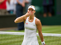 England, London, 28.06.2014. Tennis, Wimbledon, AELTC, Angelique Kerber (GER) defeats Sharapova and celebrates<br /> Photo: Tennisimages/Henk Koster