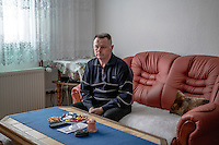 Fikret Bacic in his home. 29 members of his extended family were taken by Bosnian Serb forces and killed in July 1992. He is still searching for the remains of most of them.