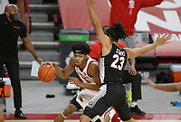 Arkansas guard Moses Moody (5) drives the ball as Georgia Mikal Starks (23) blocks, Saturday, January 9, 2021 during the first half of a basketball game at Bud Walton Arena in Fayetteville. Check out nwaonline.com/210110Daily/ for today's photo gallery. <br /> (NWA Democrat-Gazette/Charlie Kaijo)