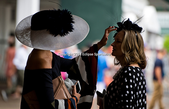 LOUISVILLE, KY - MAY 03: A woman fixes another's Derby hat during Thurby at Churchill Downs on May 3, 2018 in Louisville, Kentucky. (Photo by Scott Serio/Eclipse Sportswire/Getty Images)