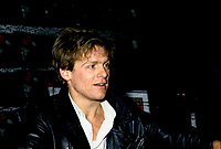 January 17, 1985 File Photo - Bryan Adams sign autographs for fans in a Montreal downtown record shop.<br /> Color images also available