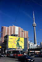 A tramway pass in front of a I Pod giant billboard ad on King and Spadina street<br />  the CN Tower is in the background.<br /> <br /> The CN Tower, located in Toronto, Ontario, Canada, is the world's tallest freestanding structure on land, standing 553.33 meters (1,815 ft 5 in) tall. It is considered the signature icon of the city, attracting more than two million international visitors annually<br /> <br /> Photo : Pierre Roussel - Images Distribution