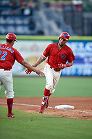 Philadelphia Phillies shortstop J.P. Crawford (12) is congratulated by manager Shawn Williams (22) after hitting a home run during a game against the Florida Fire Frogs while on rehab assignment with the Clearwater Threshers on June 1, 2018 at Spectrum Field in Clearwater, Florida.  Florida defeated Clearwater 12-10.  (Mike Janes/Four Seam Images)