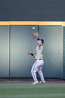 Vanderbilt Commodores outfielder Pat DeMarco (18) makes a catch against the Michigan Wolverines during Game 3 of the NCAA College World Series Finals on June 26, 2019 at TD Ameritrade Park in Omaha, Nebraska. Vanderbilt defeated Michigan 8-2 to win the National Championship. (Andrew Woolley/Four Seam Images)