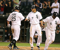 Jerry Owens of the Chicago White Sox greets Jim Thome after a homerun as Juan Uribe heads back to the dugout vs. the Florida Marlins: June 19th, 2007 at Wrigley Field in Chicago, IL.  Photo by Mike Janes/Four Seam Images