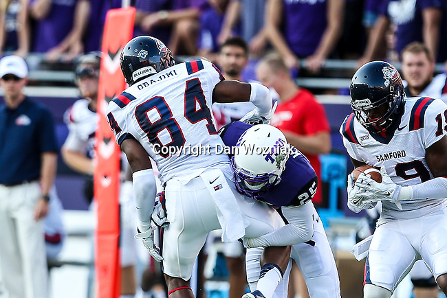 Samford Bulldogs wide receiver Emmanuel Obajimi (84) and TCU Horned Frogs safety Michael Downing (25) in action during the game between the Samford Bulldogs and the TCU Horned Frogs at the Amon G. Carter Stadium in Fort Worth, Texas.  TCU leads Stamford 24 to 7 at halftime.