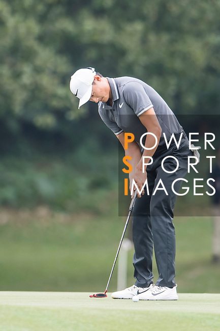 Haotong Li of China hits a shot during the day three of UBS Hong Kong Open 2017 at the Hong Kong Golf Club on 25 November 2017, in Hong Kong, Hong Kong. Photo by Marcio Rodrigo Machado / Power Sport Images