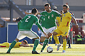 Romania's Alexandru Chipciu is blocked by Northern Ireland's 4 Gareth McAuley and 2 Conor McLaughlin during the UEFA EURO 2016 qualifying Group F soccer match between Northern Ireland and Romania at Windsor Park in Belfast, Northern Ireland, 13 June 2015.  EPA/PauL McErlane